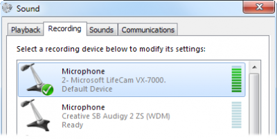 To the right of the microphone icon, the green bars move up and down as the microphone picks up sound.
